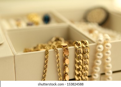 Gold jewelry and pearls in a box Copy Space