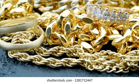 Gold jewelry pile with diamond ring