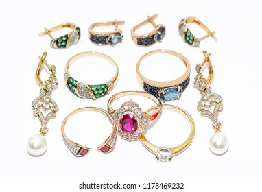 gold jewelry with precious stones and pearls
