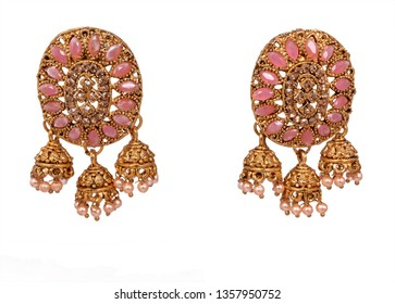 A Gold Jhumka is the most preferred choice of gold earring for women when it comes to pairing with traditional wear. Heavy and detailed,