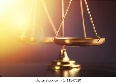 Gold justice or law  scale and sunligth