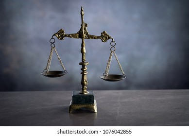 gold justice scale, dark background