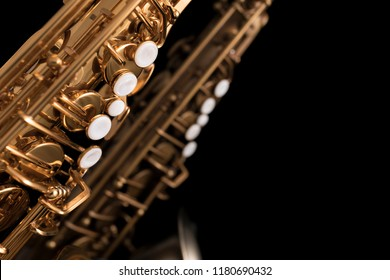 Gold lacquered and matte finish saxophones with pearl keys on bl