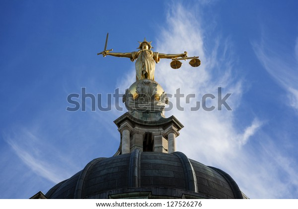 Gold Lady Justice Statue on the top of the Old Bailey in London, England.