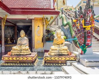 Gold leaf covered statues of Buddha at a temple near Ko Samui, Thailand