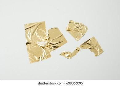 Gold leaf on white background