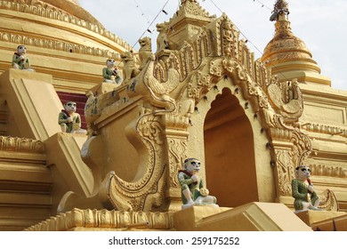Gold leaf and paint decorate a Buddhist temple near Mandalay in Myanmar.