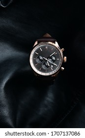 Gold LEATHER WATCH, VINTAGE STYLE WRIST WATCH, MEN'S LEATHER WATCH on leather background blur.