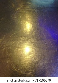 gold light on stainless steel texture background