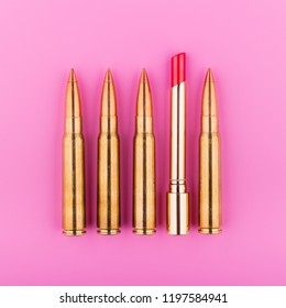 Gold Lipstick With Bullets On Pink