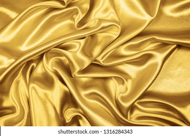 Gold luxury satin fabric texture for background