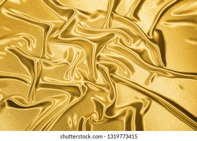 Gold luxury satin fabric texture for background and art design