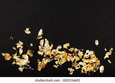 Gold luxury wealth holiday background. Gold foil flakes, patal, on the background. View from above. Finished work for your project. Luxury,