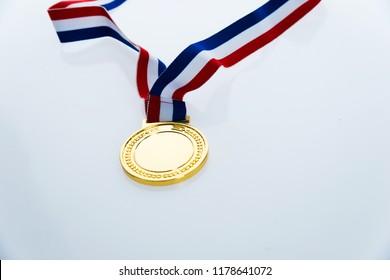 Gold madal isolated on white background.
