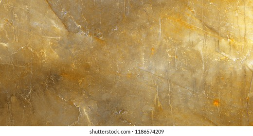 Gold marble texture (Natural pattern for backdrop or background, Can also be used for create surface effect to architectural slab, ceramic floor and wall tiles). Natural golden marble closeup