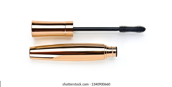 gold  mascara wand and tube on white background with clipping path