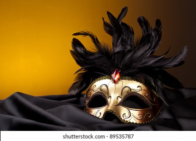 gold mask on black silk