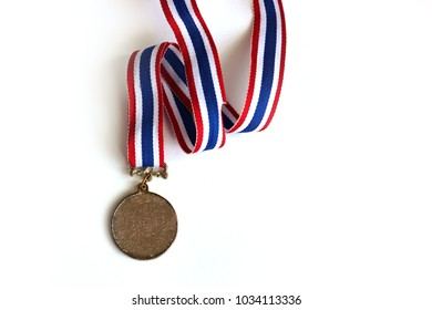 Gold medal with empty medal with red white blue ribbon isolated on white background