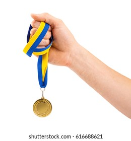 gold medal in hand on white background