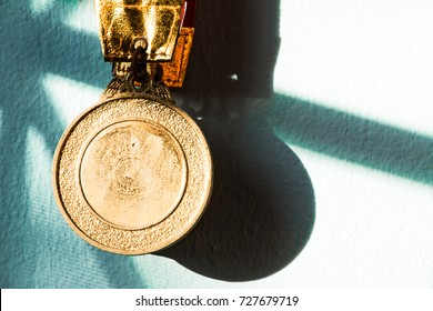 Gold medal is hanging on the wall represent of victory and joy