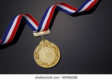 Gold medal on black background?