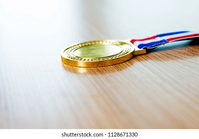 Gold medal on wooden table.