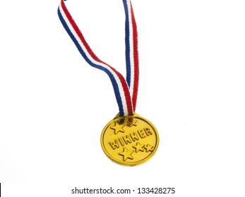Gold medal winner pendant on a white background