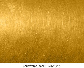The gold metal texture with circular scratches.