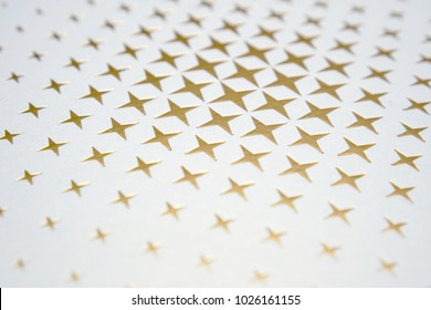 Gold Metallic Star Shining on Paper Background