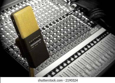 Gold mic with soundboard background