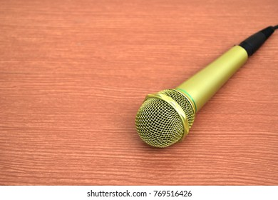 gold microphone on table