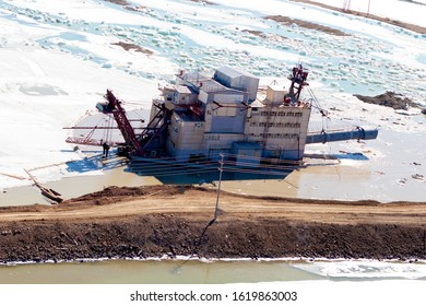 Gold mining. Dredge is mining gold