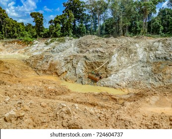 Gold mining place in Guyana, gold mining pit. Amazon and Essequibo basin deforestation. Rainforest destruction, mercury contamination.