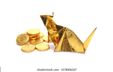 Gold mouse origami paper art with  gold coins isolated on white background. The symbol of wealth and richness in Chinese culture, Chinese zodiac
