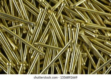 A lot of Gold nails - macro photo.