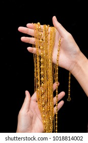 Gold neck lace ,Gold jewelry in woman's hands