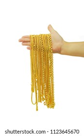 gold necklace in human hand isolated on white