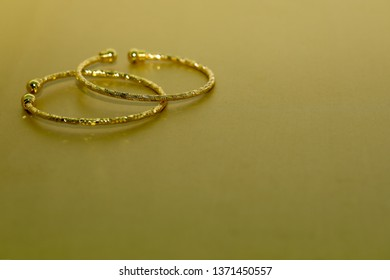 Gold necklace on gold background. Expensive luxury necklace. Decorative gold necklace with copyspace, selective focus. gold jewelry.