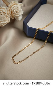 Gold necklace on the case