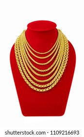 Gold necklace on necklace display stand. Gold necklaces on red mannequin