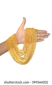 gold necklace on hand