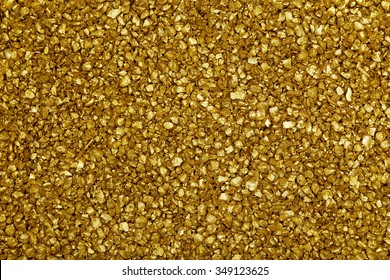 Gold nugget grains background, close-up