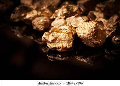 Gold nuggets isolated on black background.