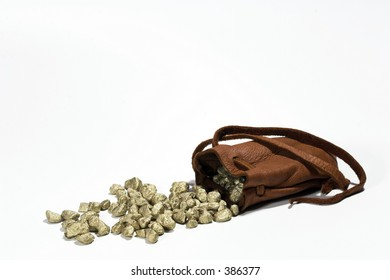 Gold nuggets spilling from a leather pouch.  Riches.  Wealth.