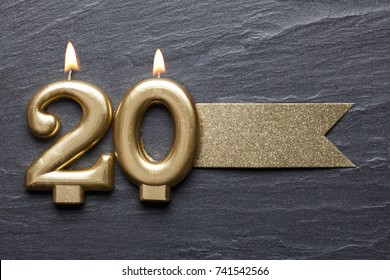 Gold number 20 celebration candle with glitter label