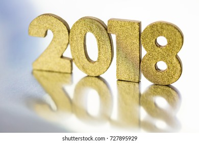 Gold numbers of 2018 year on a silver background.