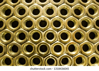Gold nuts on black background. Abstract industry background. Natural photo.