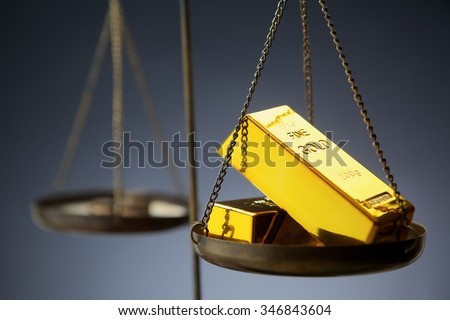 Gold on the scales
