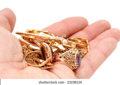 Gold ornaments in a hand