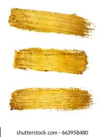 Gold paint brush stroke isolated on white background.